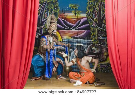 Two actors dressed-up as Rama and Ravana the Hindu mythological characters
