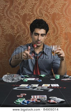 Man throwing dices on a table