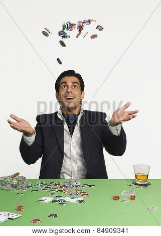 Man tossing gambling chips in a casino