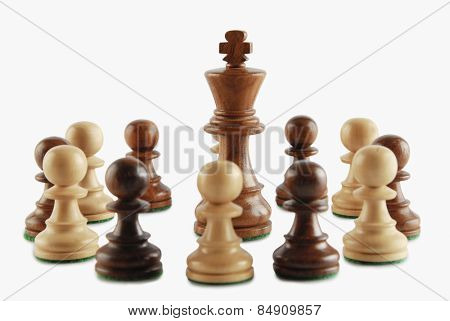 King surrounded by chess pawns