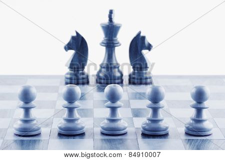 Close-up of chess pieces on a chessboard
