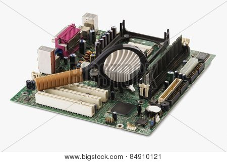 Close-up of a mother board and a magnifying glass