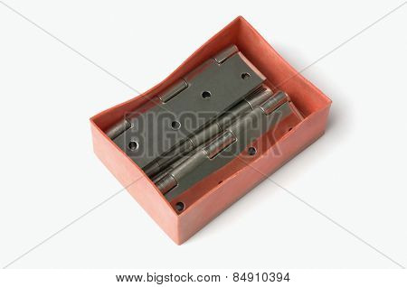 Close-up of door hinges in a box