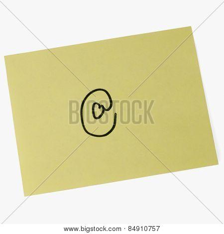 At symbol on an adhesive note