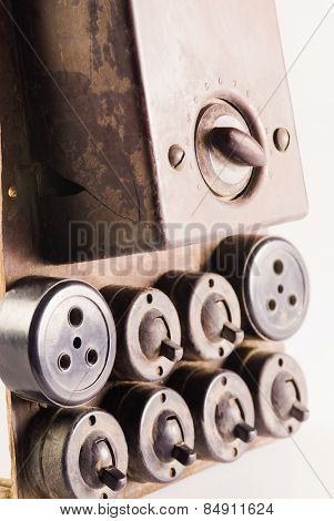Close-up of an obsolete light-switches and sockets