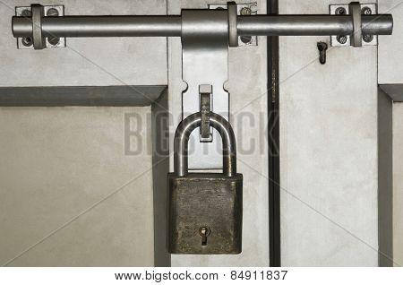 Close-up of a door locked with a padlock