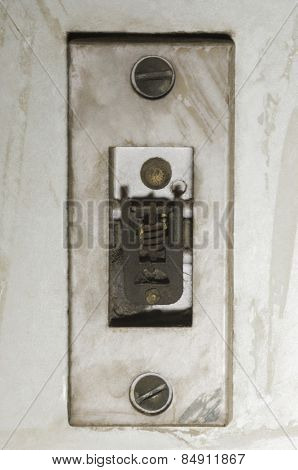 Close-up of a damaged door bell switch