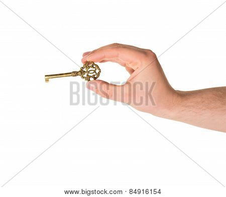 Hand holding a key isolated