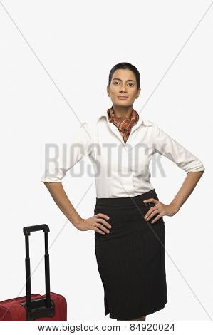 Portrait of an air hostess with her luggage
