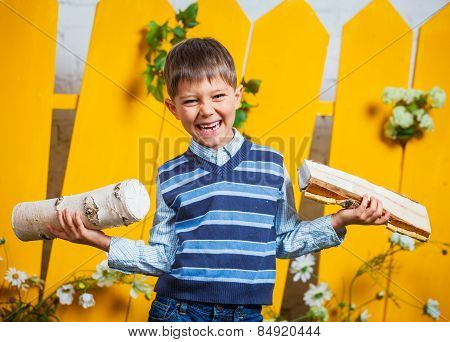 Boy with pile of firewood