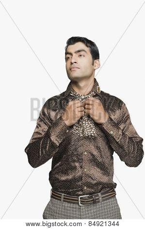 Businessman holding his cravat