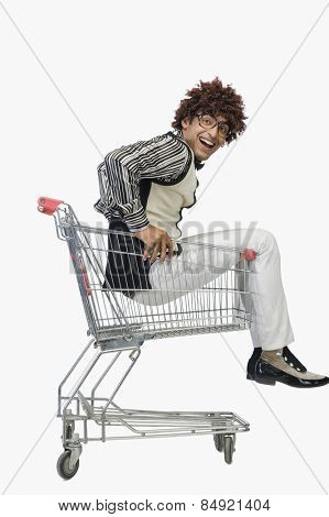 Portrait of a man sitting in a shopping cart
