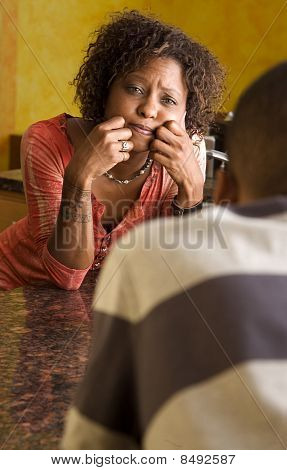 African-american Couple Talks In Kitchen