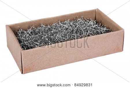 Close-up of straight pins in a box
