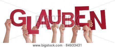 People Holding German Word Glauben Means Believe