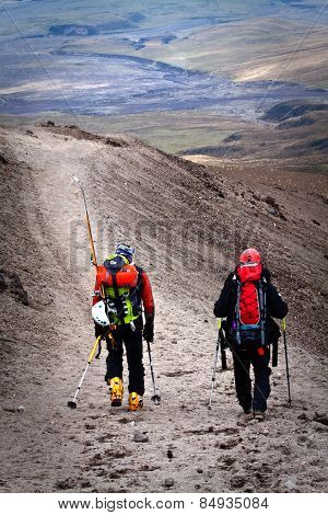 Unidentified hikers in Cotopaxi volcano, one of the world's highest volcanoes.