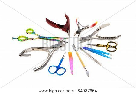 Tools, scissors of a manicure set on a white background