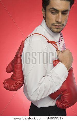 Businessman holding boxing gloves