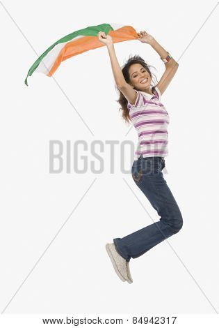 Portrait of a woman jumping with an Indian flag