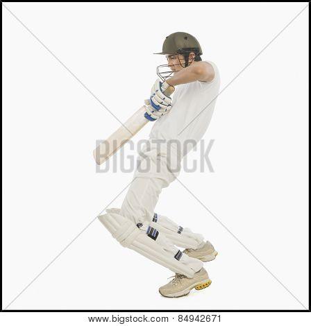 Cricket batsman playing a square cut shot