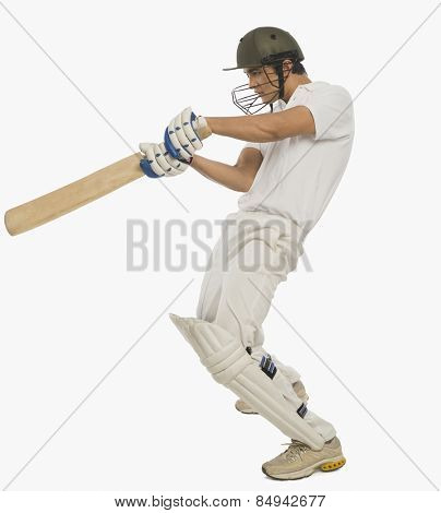 Cricket batsman playing a square cut shot