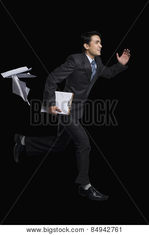 Businessman running with a clipboard