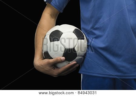 Mid section view of a soccer player with a soccer ball