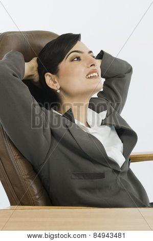 Businesswoman relaxing in an office