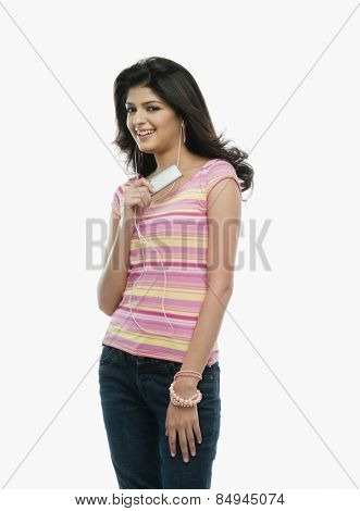 Woman listening to an mp3 player and smiling