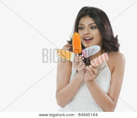 Woman holding ice creams and smiling