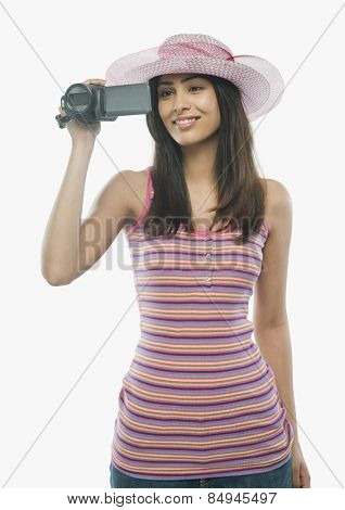 Close-up of a woman filming with a home video camera