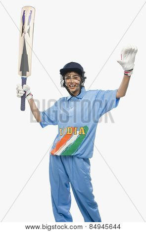 Female cricketer waving her arms in celebration