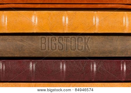 Close-up stack of leather photo albums isolated on white background