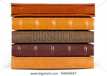 Stack of leather photo albums isolated on white background