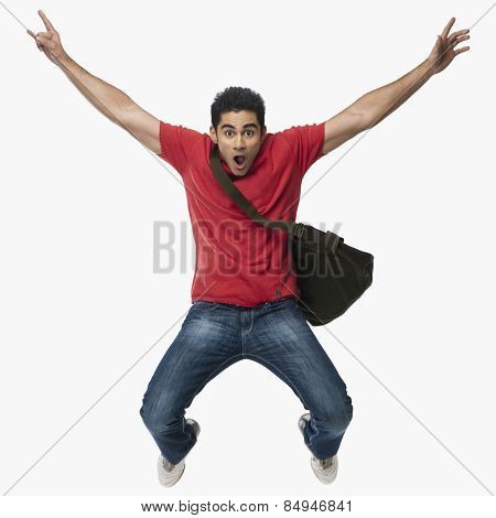 University student jumping in excitement