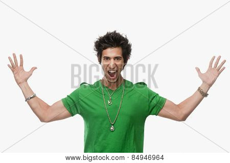 Portrait of a man shouting with arm outstretched