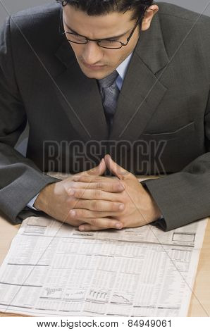 Businessman reading a financial newspaper