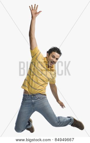 Portrait of man jumping in excitement
