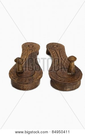 Close-up of pair of Paduka a traditional Indian wooden footwear worn by Hindu priests and Brahmins