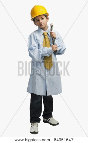 Boy dressed as an architect and holding hammer