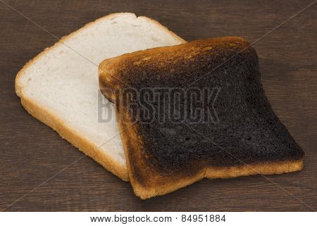 Slice of bread with burnt toast