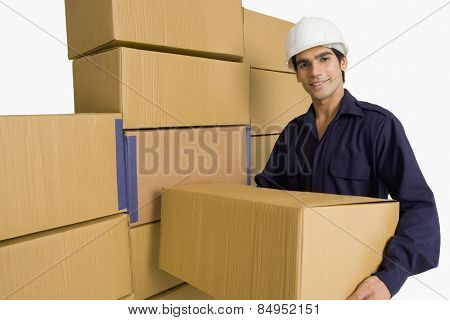 Warehouse worker carrying a cardboard box