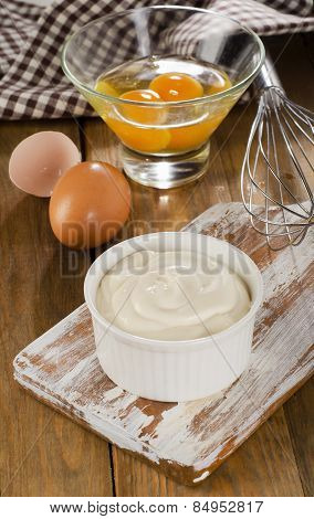 Mayonnaise In A Bowl With Eggs  On A Wooden Background