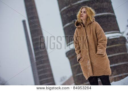The Girl In The Coat On The Street