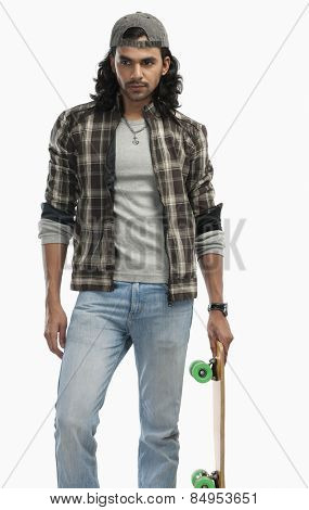 Man holding a skateboard