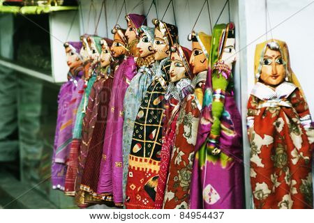 Wooden puppets hanging at a market stall, Delhi, India