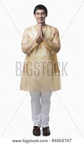 Bengali man standing in a prayer position