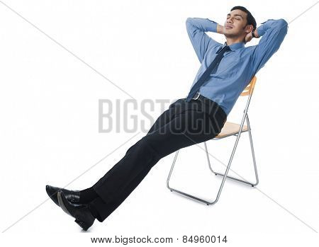 Bengali businessman reclining on a chair