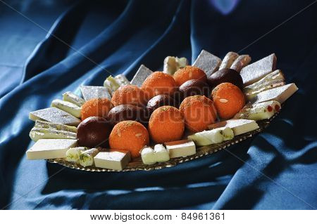 Close-up of traditional Indian sweets on a plate