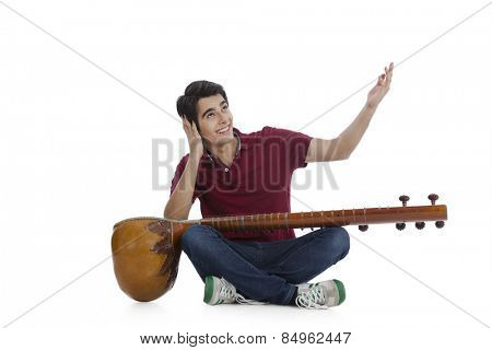 Happy man playing a sitar and singing